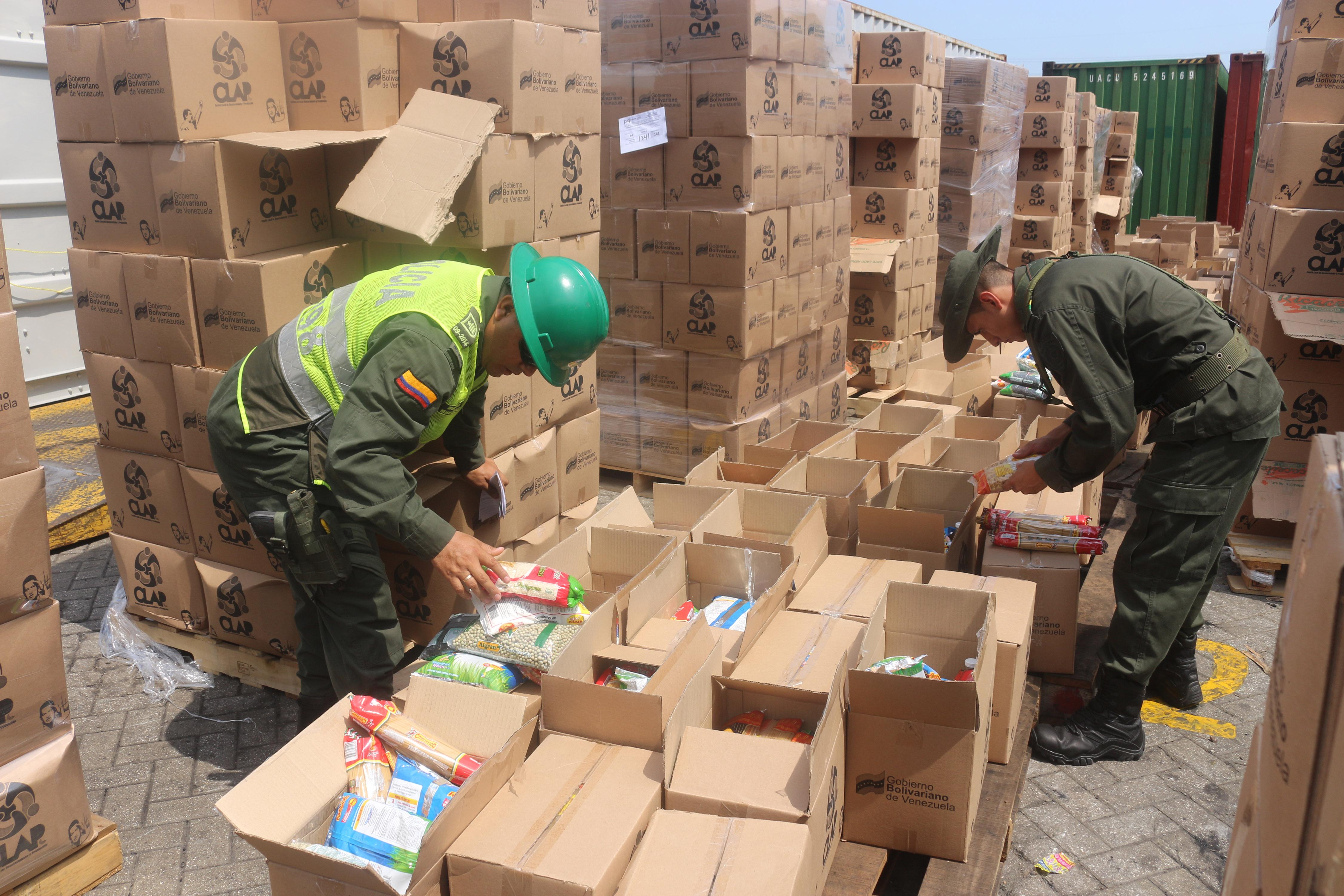 Resultado de imagen para que decomisaron ayer en Cartagena casi 400 toneladas de alimentos no aptos para consumo que iban a ser repartidos por Comités